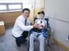 강남세브란스병원, 척추후만증 하지마비 몽골 소년 수술 지원